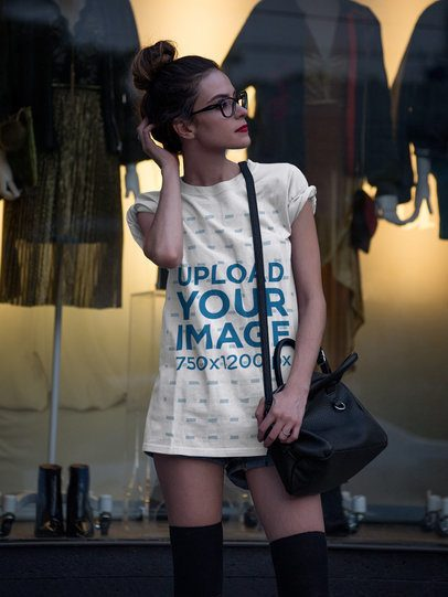 Pretty Girl Wearing a T-Shirt Template and Shorts While Outside a Yellow Store a17353