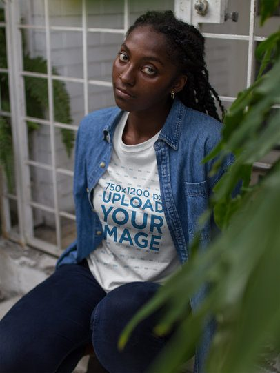 Beautiful Black Woman Wearing a Round Neck Tee Mockup Near Plants a17315