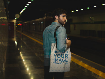 Man Carrying a Tote Bag Mockup in a Subway Station a17096