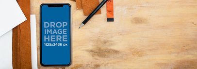 iPhone X Mockup Lying on a Space Work Near Pencils and Leather Strips a17507