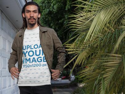 Asian Man Posing in the Street Wearing a T-Shirt Mockup a17592