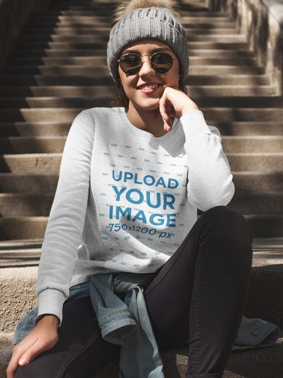 Pretty Girl Wearing a Crewneck Sweatshirt Template While SItting on Stairs a17671