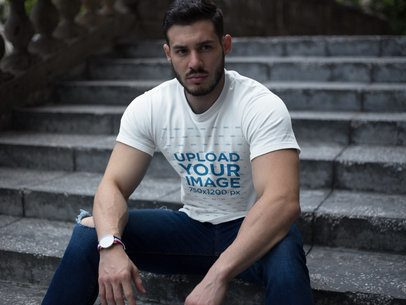 Strong Dude Wearing a T-Shirt Mockup While Sitting on Stairs a17660