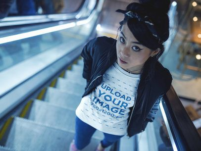 Beautiful Girl Wearing a Tshirt Mockup while Using Electric Stairways a17814
