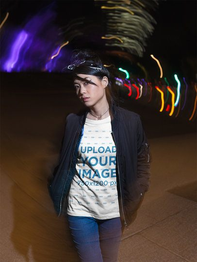 Trendy Girl Wearing a T-Shirt Mockup While Walking on the Street at Night a17815