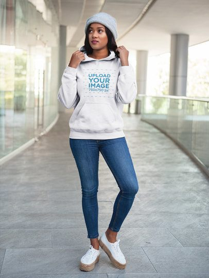 Mockup of a Young Woman Wearing a Pullover Hoodie While at a Shopping Center 17747
