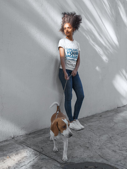 Curly Haired Girl Wearing a Tshirt Mockup While Walking Her Dog a17843