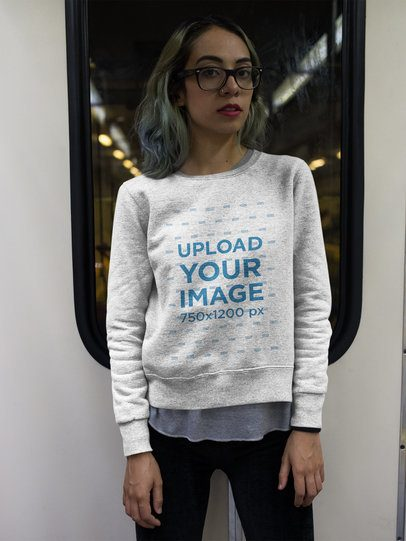 Hipster Girl Wearing a Crewneck Sweatshirt Template while Looking to the Camera a17645