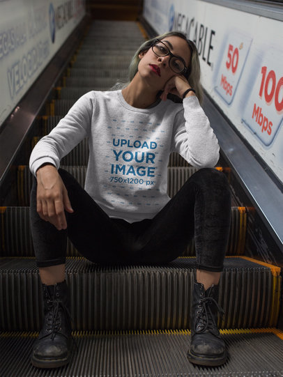 Girl Wearing a Crewneck Sweatshirt Template Sitting on Electric Stairways a17651