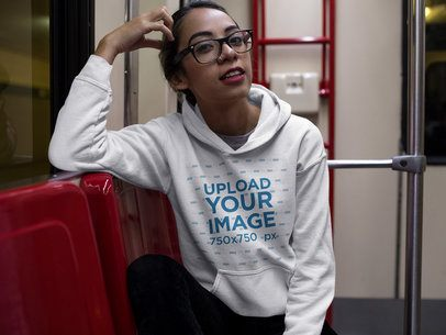 Happy Hispanic Girl Wearing a Pullover Hoodie Template While in the Metro a17650