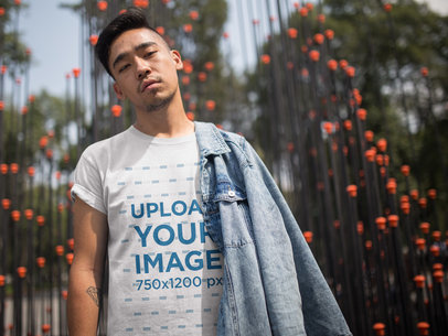 Cool Asian Dude Wearing a Tshirt Template While Near an Urban Art Structure a17832
