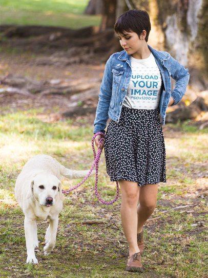 Girl Walking her Dog Wearing a T-Shirt Mockup at a Park a17973