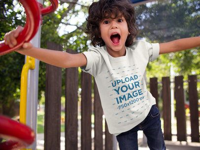 Screaming Kid Wearing a T-Shirt Mockup at the Park a17868