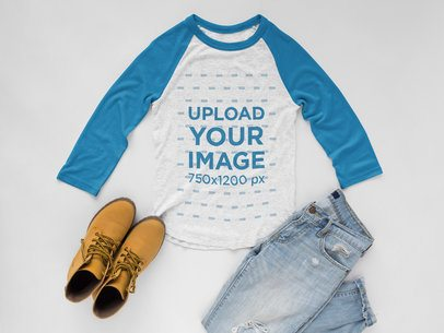 Raglan Tee Mockup with Casual Outfit on White Surface a17956