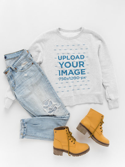 Crewneck Sweater Template Lying Next to Daily Outfit a17958