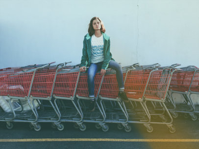 Woman Sitting on Shopping Carts Wearing a T-Shirt Mockup a18474