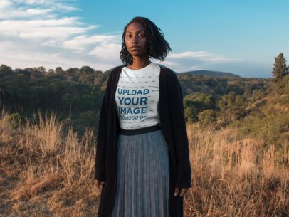 Mockup of a Black Woman Wearing a Tshirt While Outdoors on the Mountains a18514