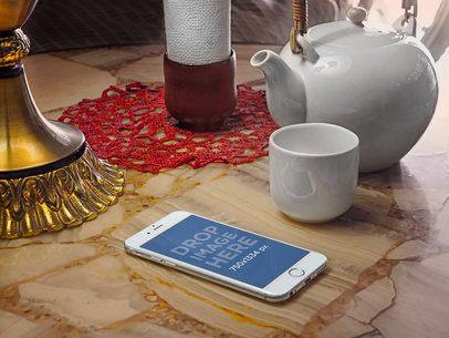 White iPhone 6 On Tea Shop