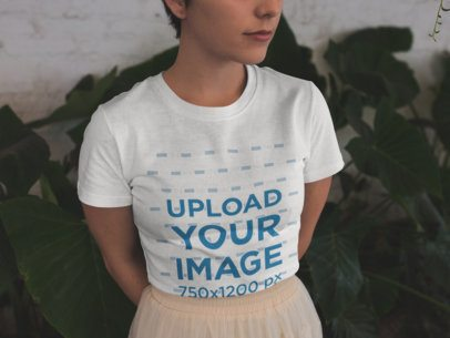 Closeup of a Cropped Face Girl Wearing a T-Shirt Mockup and a Skirt Near Plants a18469