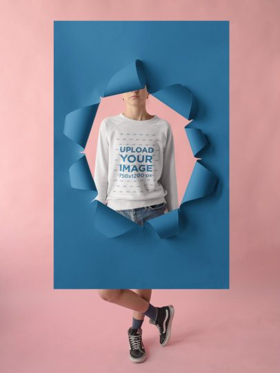 Girl Wearing a Crewneck Sweatshirt Template Behind a Hole in a Poster Board a18509