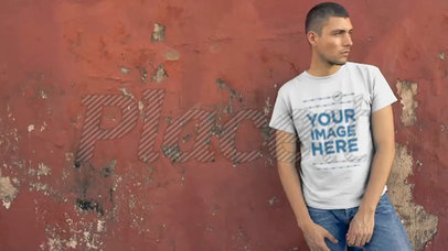Serious Man Wearing a T-Shirt Video Mockup Against an Old Wall 12233a