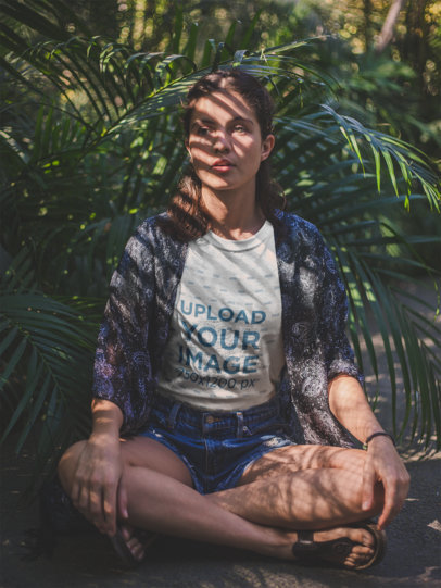 White Girl Sitting Down Near Plants Wearing a T-Shirt Mockup a18463