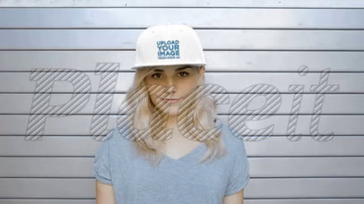 Beautiful Young Lady Wearing a Snapback Hat Video Mockup While Against a Metal Curtain a14140