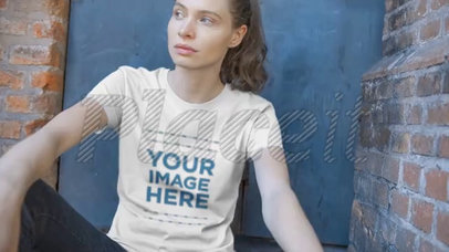Beautiful Girl Sitting Outside Her House Wearing a Short Sleeved T-Shirt Video a12914