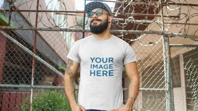 Hipster Guy with a Beard Wearing a Round Neck T-Shirt Video Mockup and a Snapback Hat a12261