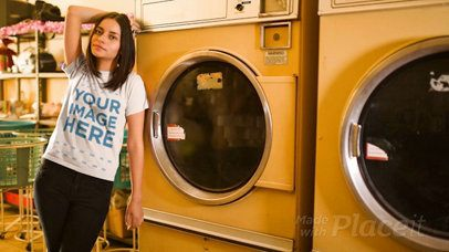 Young Woman Wearing a T-Shirt Cinemagraph Mockup Against a Washing Machine at a Laundry a13402