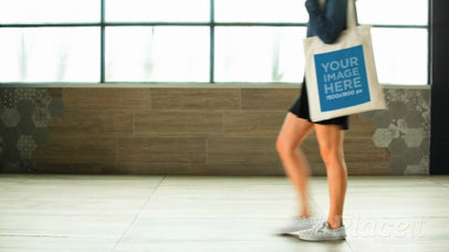 Girl Walking Near A Window Holding a Tote Bag Video a13719