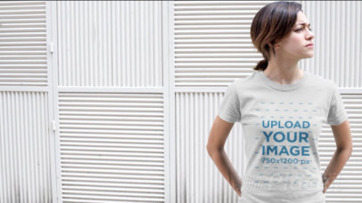 Video of a Young Woman Standing Near a White Wall Wearing a Round Neck T-Shirt a12148