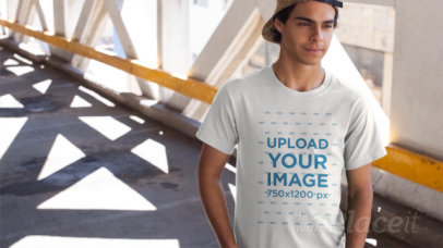 Young Dude Wearing a T-Shirt Video Mockup on a Bridge a12867