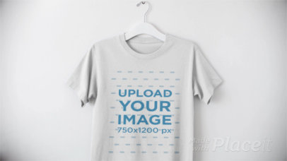 T-Shirt on a Hanger Video Mockup Against a White Background a13090
