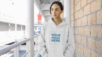 Young Woman Wearing a Pullover Hoodie Video at a Hallway a13207