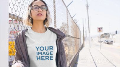Short Haired Girl Walking Near a Fence Wearing a T-Shirt Video a13462