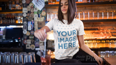 Trendy Girl Stirring a Drink at a Bar Wearing a T-Shirt Cinemagraph a13400