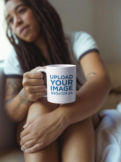 Girl with Dreadlocks Holding a Mug Mockup Watching to the Window a17304