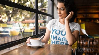 Woman at a Cafe While Wearing a Round Neck Tshirt Cinemagraph Mockup a13442