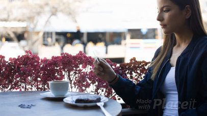 Gorgeous Woman Looking at a Business Card Video While at a Cafe a13947