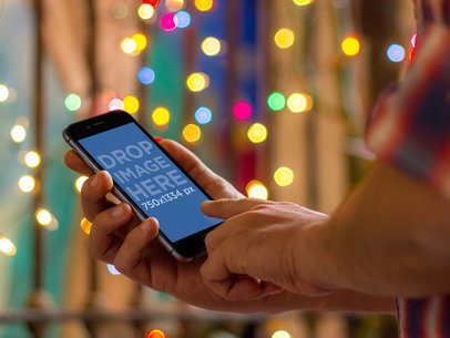 Man Using iPhone 6 During Christmas
