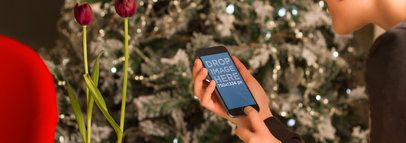 iPhone 6 Mockup in Front of a Christmas Tree