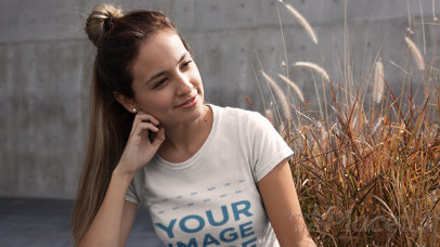 Girl with a Hair Bun Wearing a Round Neck Tee Stop Motion Video Outdoors a13238