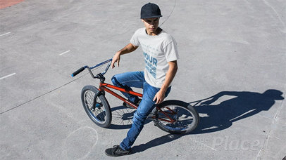 Young Man Wearing a Round Neck Tshirt Stop Motion While Sitting on His Bike a13354