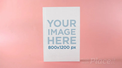 Ebook Floating Against a Changing Blue and Pink Background in Stop Motion a13679