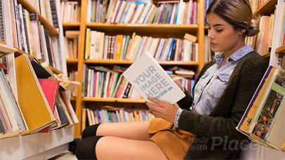 Girl Sitting Down inside a Library While Reading a Book in Stop Motion a13747