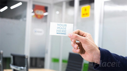 Mockup of a Hand Holding a Business Card Stop Motion in a  Professional Environment a13729