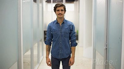 Millennial Guy with Moustache Wearing a Denim Jacket Shows you a Business Card in Stop Motion a13730