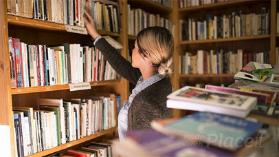Girl Picking Up a Book in Stop Motion From Library a13744