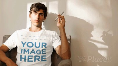 Cinemagraph of a Young White Man Playing With a Pen Wearing a Round Neck T-Shirt Mockup a13331